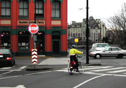 A cyclist who is visible on the road