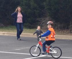 Brennan riding his bike