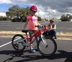 Mia with her Mom and younger brother during her bicycle training