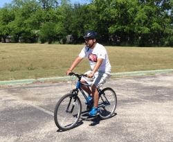 Tony riding a mountain bike